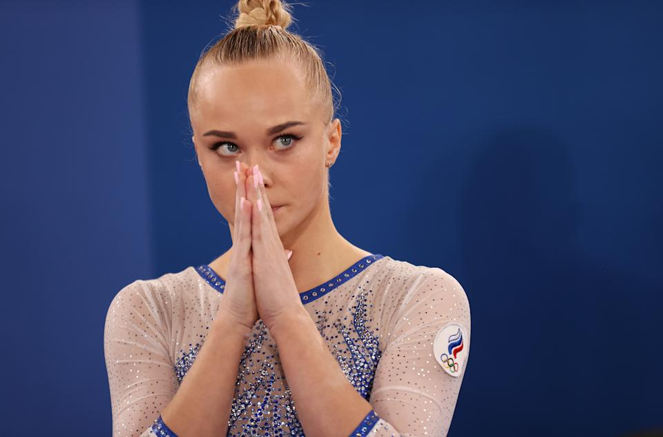 <p>TOKYO, JAPAN - JULY 27: Angelina Melnikova of Team ROC looks on during the Women's Team Final on day four of the Tokyo 2020 Olympic Games at Ariake Gymnastics Centre on July 27, 2021 in Tokyo, Japan. (Photo by Laurence Griffiths/Getty Images)</p>