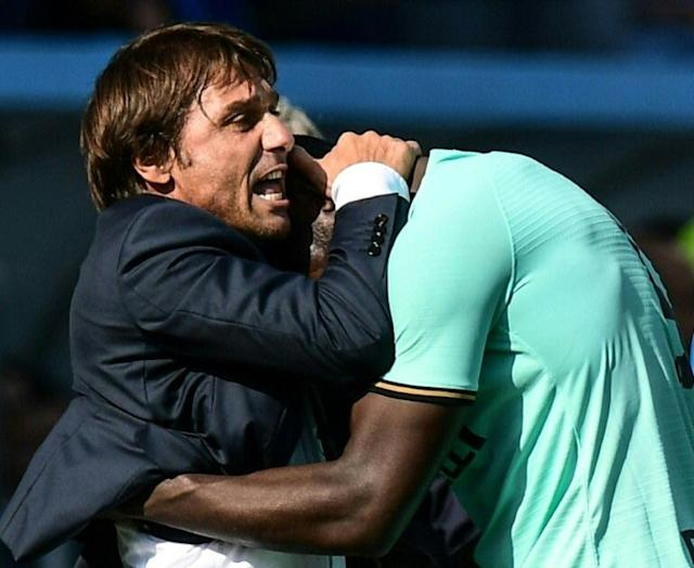 """""""The best manager in the world:"""" Inter Milan forward Romelu Lukaku (R) is thriving under new coach Antonio Conte. (AFP Photo/Miguel MEDINA)"""