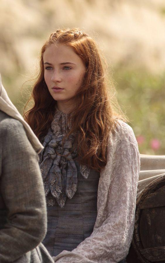 <p>Sansa's high necklines and bunches of ruffles look out of place with a sunny backdrop. She might have been ready to move on, but she still sticks out as an outsider. She'll have to really learn to blend in if she wants to survive (~foreshadowing~). </p>