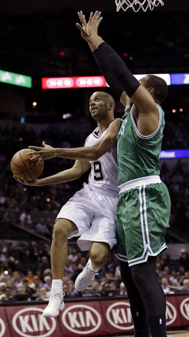 San Antonio Spurs' Tony Parker (9), of France, shoots over Jared Sullinger, right, during the first half of an NBA basketball game, Wednesday, Nov. 20, 2013, in San Antonio. (AP Photo/Eric Gay)