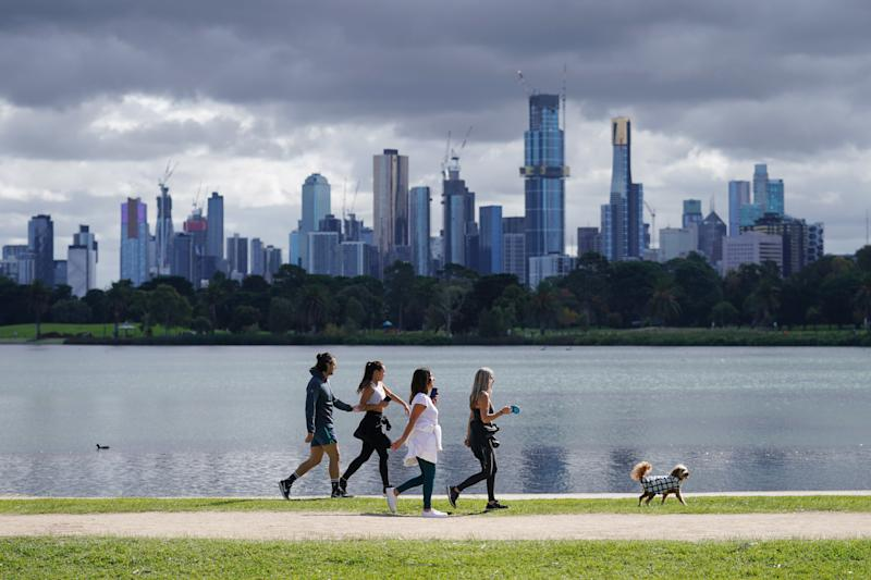 People exercise at Albert Park Lake in Melbourne, Saturday, April 18, 2020.