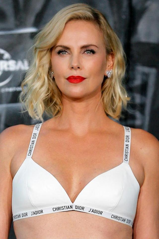 <p>The leading lady of <em>Atomic Blonde </em>rocked a Christian Dior bra with tousled waves and a cherry red lip to the film's world premiere in Berlin, Germany. (Photo: Franziska Krug/Getty Images for Carl F. Bucherer) </p>