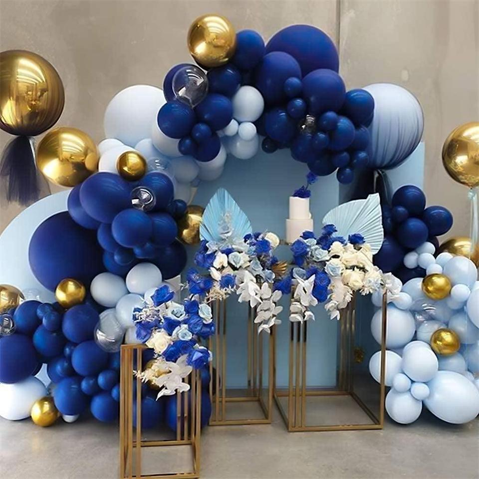 <p>Embrace the blue aesthetic with this <span>Nalwort 135-Piece Navy Blue Metallic Gold Balloon Arch Kit</span> ($18).</p>