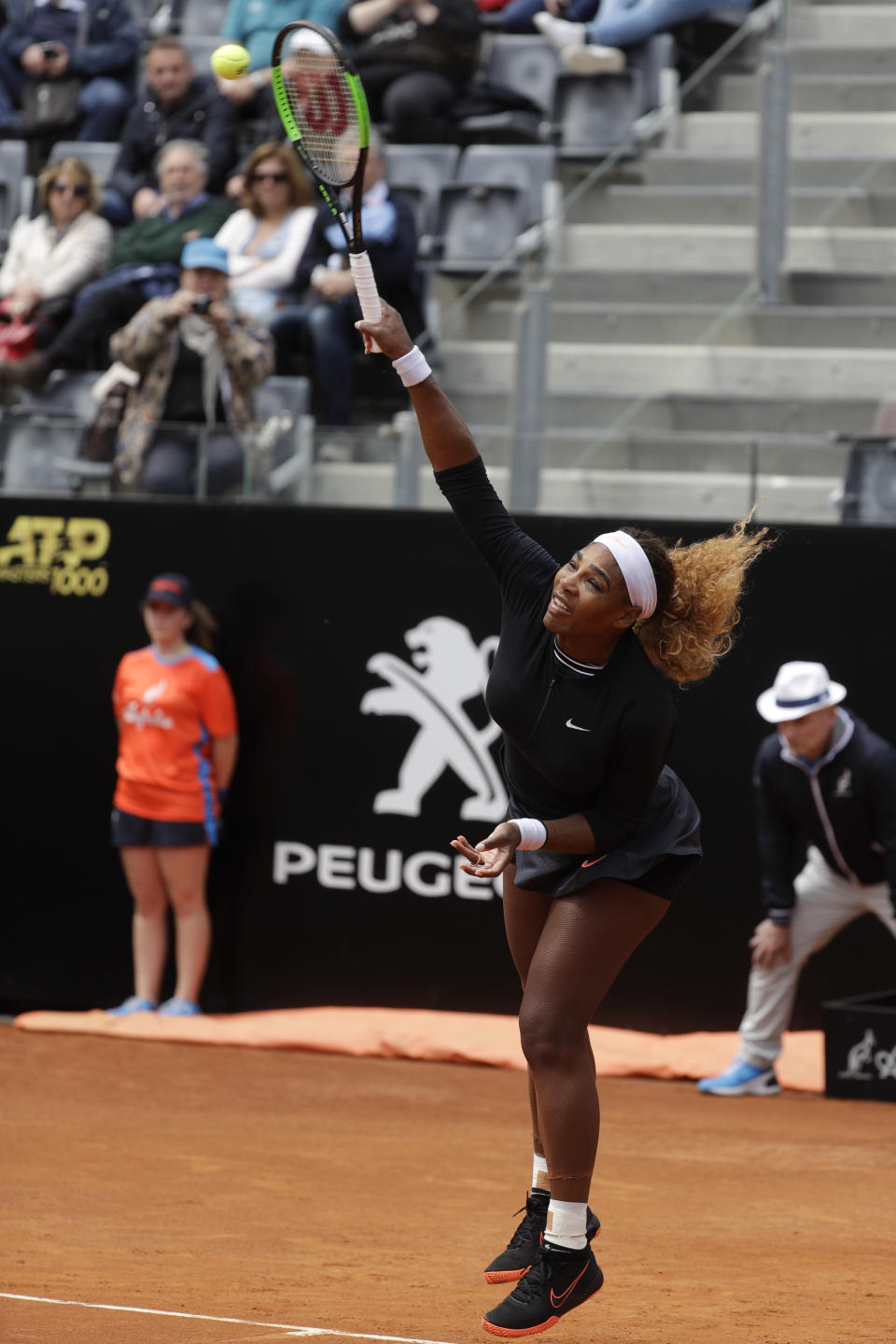 Serena Williams, of the United States, serves the ball to Sweden's Rebecca Peterson during their match at the Italian Open tennis tournament, in Rome, Monday, May, 13, 2019. (AP Photo/Gregorio Borgia)