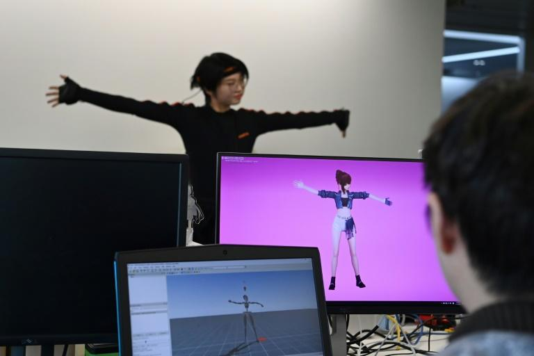 To get the virtual pop stars onto a real-life stage, producers use a mixture of computer animation and real-time motion-capture technology with an actor