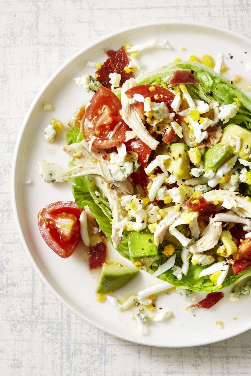 """<p>If you're craving some veggies post-turkey day, toss your leftovers into this 20-minute light and crisp dinner salad loaded with avocado and tomatoes. Don't forget the bacon; it makes this salad feel extra decadent.</p><p><em><a href=""""https://www.goodhousekeeping.com/food-recipes/easy/a45233/rotisserie-chicken-cobb-salad-recipe/"""" rel=""""nofollow noopener"""" target=""""_blank"""" data-ylk=""""slk:Get the recipe for Turkey Cobb Salad »"""" class=""""link rapid-noclick-resp"""">Get the recipe for Turkey Cobb Salad »</a></em></p>"""