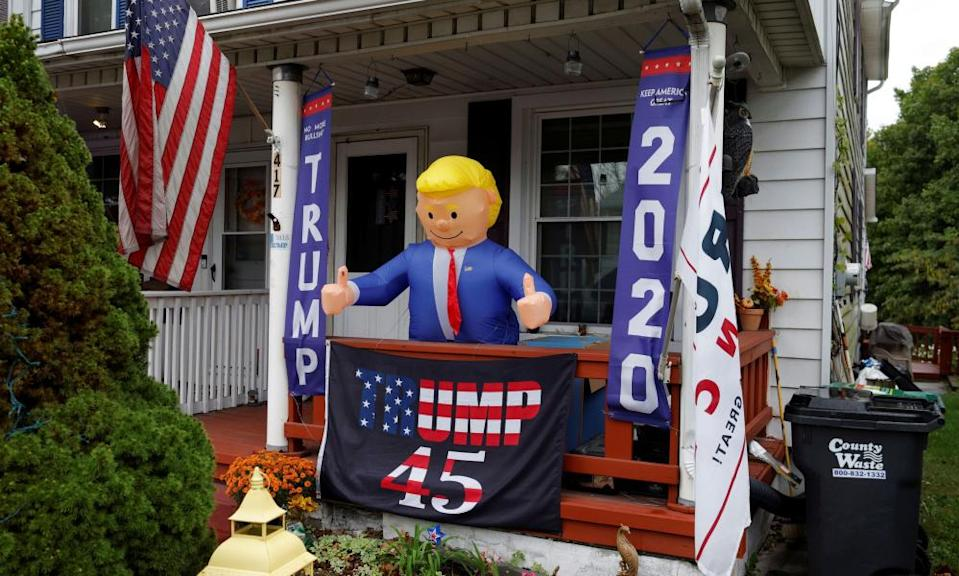An inflatable figure of Donald Trump stands on a porch int he Northampton county borough of Stockertown.