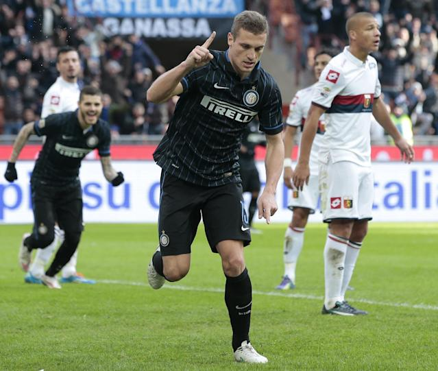 Inter Milan's Nemanja Vidic celebrates scoring against Genoa on January 11, 2015 at the San Siro, helping his side to a 3-1 victory (AFP Photo/Emilio Andreoli)