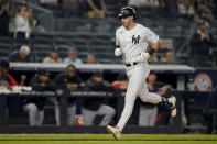 New York Yankees' Joey Gallo runs the bases after hitting a solo home run off Cleveland Indians starting pitcher Zach Plesac during the second inning of a baseball game Friday, Sept. 17, 2021, in New York. (AP Photo/John Minchillo)