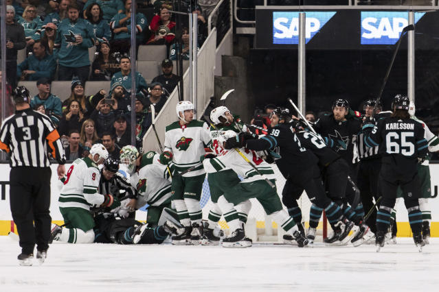 A fight breaks out between the San Jose Sharks and the Minnesota Wild during the second period of an NHL hockey game Thursday, Nov. 7, 2019, in San Jose, Calif. (AP Photo/John Hefti)