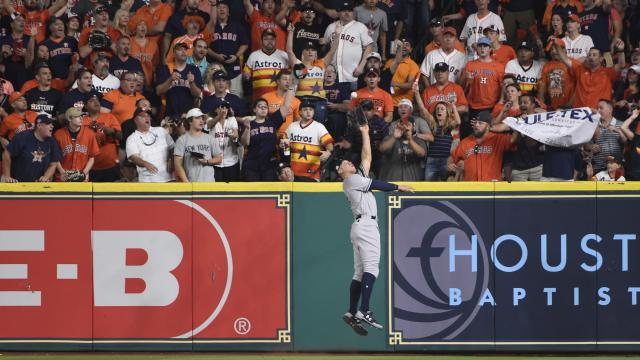 New York Yankees' Aaron Judge catches a long fly ball hit by Houston Astros' Yuli Gurriel during the second inning of Game 7 of baseball's American League Championship Series Saturday, Oct. 21, 2017, in Houston. (AP Photo/Eric Christian Smith)