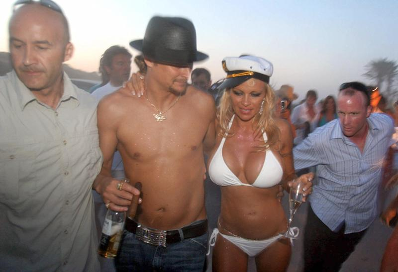 A photo of Canadian actress Pamela Anderson wearing a white bikini with her shirtless husband, US musician Kid Rock, on the day of their wedding on Pampelone's beach in Saint-Tropez, Southern France, 29 July 2006.