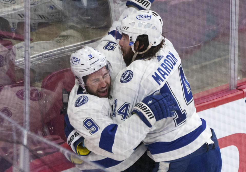 Tampa Bay Lightning's Tyler Johnson, left, celebrates his goal against the Montreal Canadiens with Pat Maroon during the third period of Game 3 of the NHL hockey Stanley Cup Final, Friday, July 2, 2021, in Montreal. (Paul Chiasson/The Canadian Press via AP)