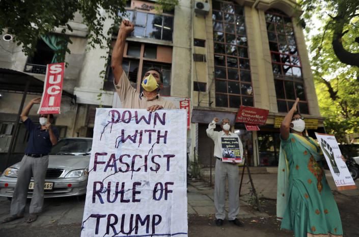 Activists of Socialist Unity Centre of India shout slogans in Ahmedabad, India, Tuesday, June 2, 2020 in solidarity with protests against the recent killing of George Floyd, a black man who died in police custody in Minneapolis, U.S.A., after being restrained by police officers on Memorial Day. (AP Photo/Ajit Solanki)