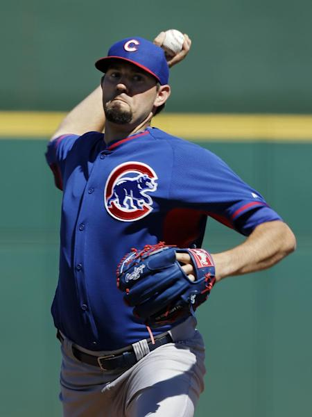 Chicago Cubs starting pitcher Jason Hammel delivers against the Cincinnati Reds in the first inning of a spring training exhibition baseball game Saturday, March 8, 2014, in Goodyear, Ariz. (AP Photo/Mark Duncan)