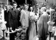 <p>Katharine Hepburn looked incredible as Tracy Lord in her chiffon ruffled wedding gown in <em>The Philadelphia Story. </em>To top off the look, Hepburn wore a wide-brimmed hat, rather than a veil.<br></p>