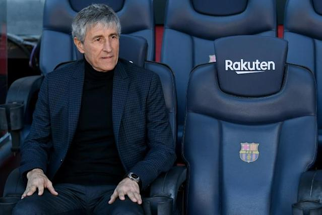 Quique Setien takes over a Barcelona side top of La Liga, through to the Champions League last 16 and alive in the Copa del Rey, but the new coach still faces numerous challenges (AFP Photo/LLUIS GENE)