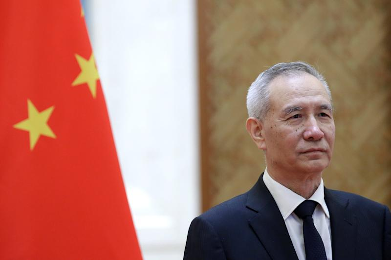 Chinese Vice Premier Liu He waits to shake hands with European Commission Vice President Katainen in Beijing
