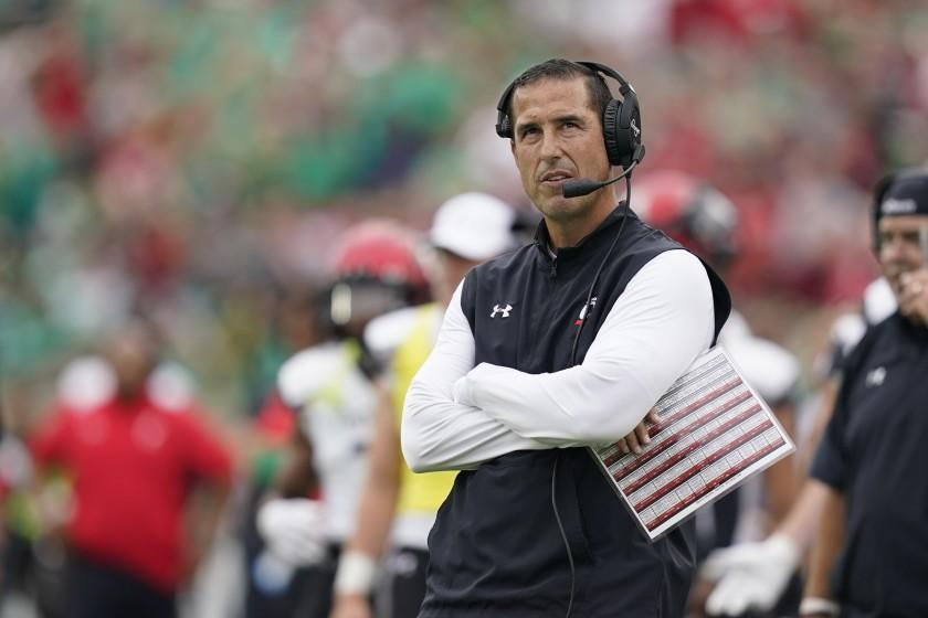 Cincinnati head coach Luke Fickell watches a replay during the first half of an NCAA college football game.