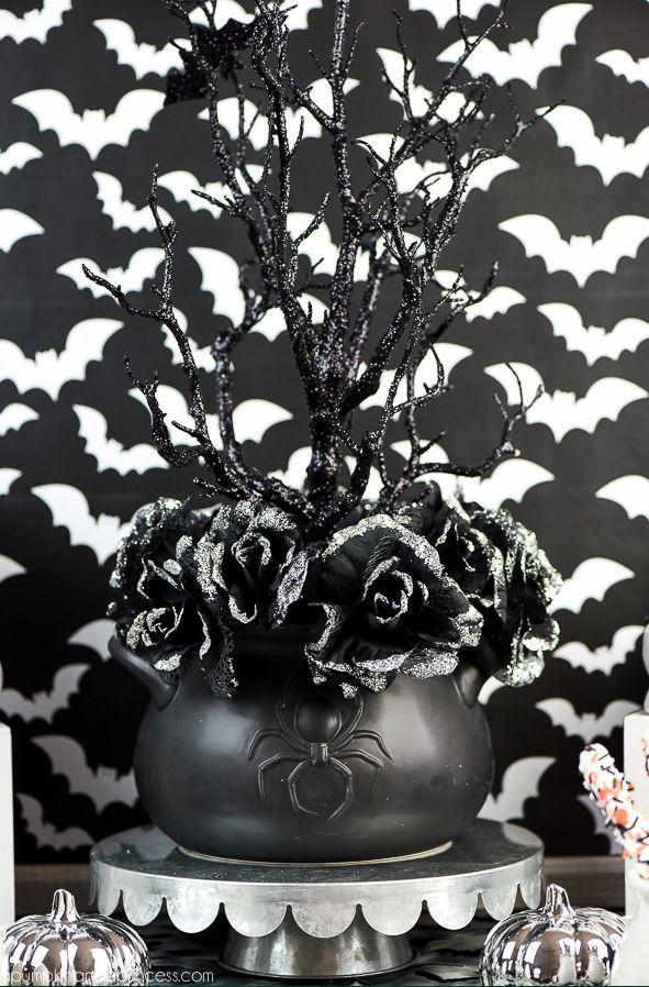 """<p>Natural elements, like branches and florals, can feel just-right for Halloween when picked in eerie shades like black or silver. <br></p><p><strong>Get the tutorial at <a href=""""https://apumpkinandaprincess.com/halloween-party-ideas-food-decorations-party-favors/"""" rel=""""nofollow noopener"""" target=""""_blank"""" data-ylk=""""slk:A Pumpkin and a Princess"""" class=""""link rapid-noclick-resp"""">A Pumpkin and a Princess</a>.</strong> </p>"""