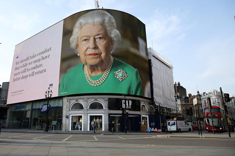 An image of Britain's Queen Elizabeth II making her her address to the UK and the Commonwealth in relation to the coronavirus epidemic is displayed on the advertising boards at Piccadilly Circus in central London on April 9, 2020, as Britain continues to battle the outbreak of Coronavirus Covid-19 and warm weather tests the nationwide lockdown as the long Easter weekend approaches. - The disease has struck at the heart of the British government, infected more than 60,000 people nationwide and killed over 7,000, with a daily death toll in England of 765 reported on April 9. (Photo by ISABEL INFANTES / AFP) (Photo by ISABEL INFANTES/AFP via Getty Images)