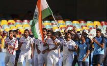 Indian players celebrate after defeating Australia by three wickets on the final day of the fourth cricket test at the Gabba, Brisbane, Australia, Tuesday, Jan. 19, 2021.India won the four test series 2-1. (AP Photo/Tertius Pickard)