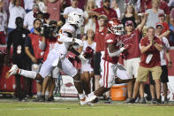 Arkansas running back AJ Green (0) slips past Texas defender B.J. Foster (25) to score a touchdown during the second half of an NCAA college football game Saturday, Sept. 11, 2021, in Fayetteville, Ark. (AP Photo/Michael Woods)