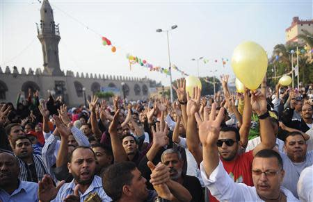 Members of the Muslim Brotherhood and supporters of ousted Egyptian President Mursi shout slogans against the military and interior ministry after Eid al-Adha prayers in Cairo