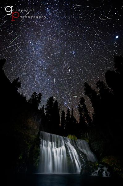 "Photographer Brad Goldpaint captured this spectacular view of the Orionid meteor shower over Middle Falls outside the city of McCloud, Calif., near Mount Shasta in 2011. The photo, called ""Nighted Veil,"" is a composite of many meteors streaking"