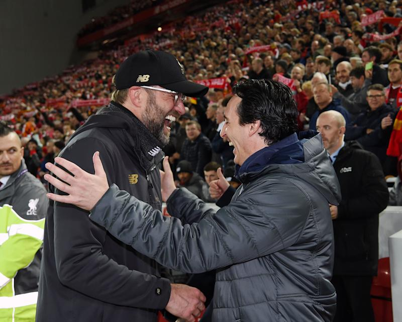 LIVERPOOL, ENGLAND - DECEMBER 29: (THE SUN OUT,THE SUN ON SUNDAY OUT) Jurgen Klopp Manager of Liverpool with Unai Emery the Manager of Arsenal during the Premier League match between Liverpool FC and Arsenal FC at Anfield on December 29, 2018 in Liverpool, United Kingdom. (Photo by John Powell/Liverpool FC via Getty Images)