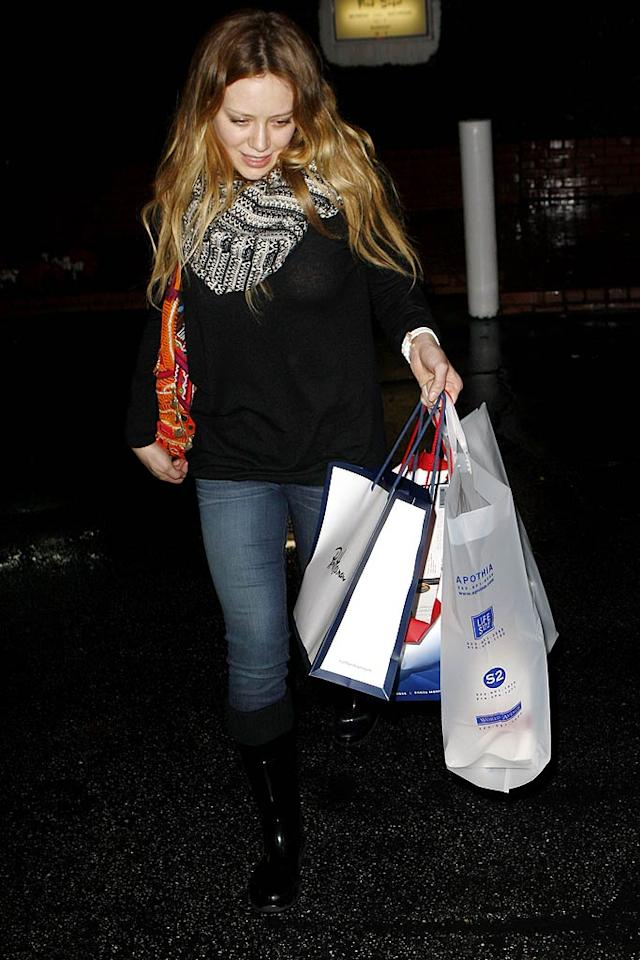 "Hilary Duff emerged from Fred Segal in West Hollywood laden with gifts. Something for her new hubby, perhaps? <a href=""http://www.infdaily.com"" target=""new"">INFDaily.com</a> - December 22, 2010"