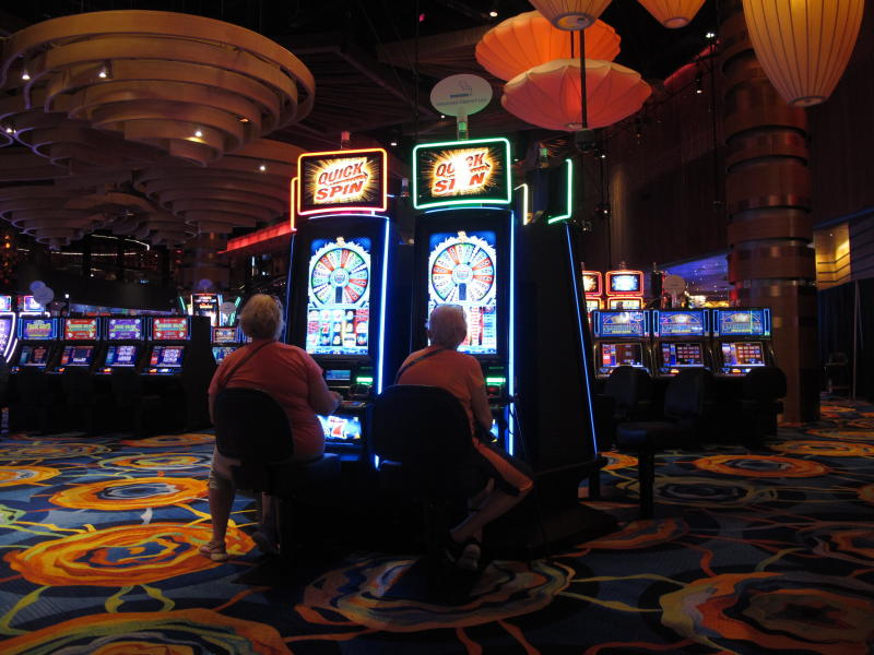 In this June 18, 2019 photo gamblers play slot machines at the Ocean Casino Resort in Atlantic City, N.J. Figures released by New Jersey gambling regulators on Friday, Nov. 22 show Atlantic City's nine casinos saw an increase in their gross operating profits of 12.5% in the third quarter of this year, to $239 million compared to the third quarter of 2018. (AP Photo/Wayne Parry)