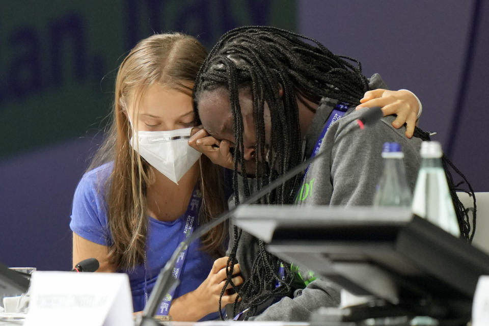 Ugandan climate activist Vanessa Nakate, right, is comforted by Swedish activist Greta Thunberg as she is overcome by emotion after speaking at the opening ofathree-dayYouth for Climatesummit in Milan, Italy, Tuesday, Sept. 28, 2021.(AP Photo/Luca Bruno)