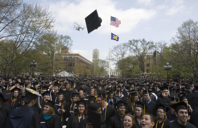 FILE - In this Saturday, April 26, 2008, file photo, University of Michigan graduates celebrate after their spring commencement ceremony, in Ann Arbor, Mich. The University of Michigan in Ann Arbor is one of 55 colleges and universities facing federal investigation for their handling of sexual abuse allegations. The school says the probe involves the school's handling of a reported 2009 violation of its sexual misconduct policy by then-football placekicker Brendan Gibbons, who was expelled in December. (AP Photo/Tony Ding, File)