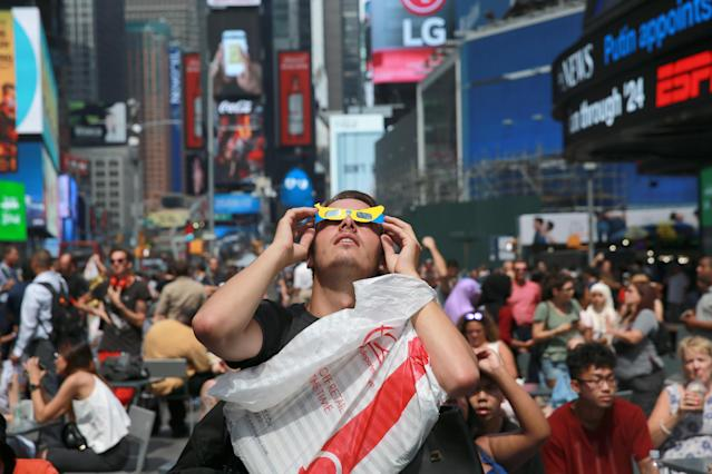 <p>A man looks up at the sun in Times Square, New York City, to watch the total solar eclipse on Aug. 21, 2017. (Gordon Donovan/Yahoo News) </p>