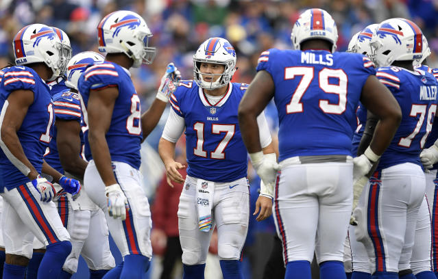 FILE - In this Oct. 7, 2018, fle photo, Buffalo Bills quarterback Josh Allen (17) calls a play in the huddle during the second half of an NFL football game against the Tennessee Titans, in Orchard Park, N.Y. Allen earned praise for continuing to grow into a team leader by organizing several workouts with teammates during the coronavirus pandemic-altered offseason. (AP Photo/Adrian Kraus)