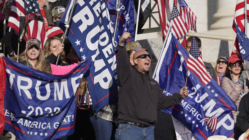 Supporters of President Donald Trump attend a rally in protest of President-elect Joe Biden election win, Wednesday, Jan. 6, 2021, in Salt Lake City. (AP Photo/Rick Bowmer)
