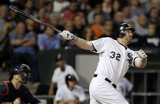 Chicago White Sox designated hitter Adam Dunn hits a two-run home run off Minnesota Twins relief pitcher Tyler Robertson, also scoring Kevin Youkilis, during the seventh inning of a baseball game, Tuesday, July 24, 2012 in Chicago. (AP Photo/Charles Rex Arbogast)