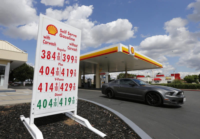 FILE - In this May 17, 2019, file photo, a car leaves a Shell station after getting gas in Sacramento, Calif. California Gov. Gavin Newsom requested on Monday, Oct. 21, that state Attorney General Xavier Becerra investigate whether the retail gasoline industry is engaging in false advertising or price fixing to charge drivers more at the pump. (AP Photo/Rich Pedroncelli, File)