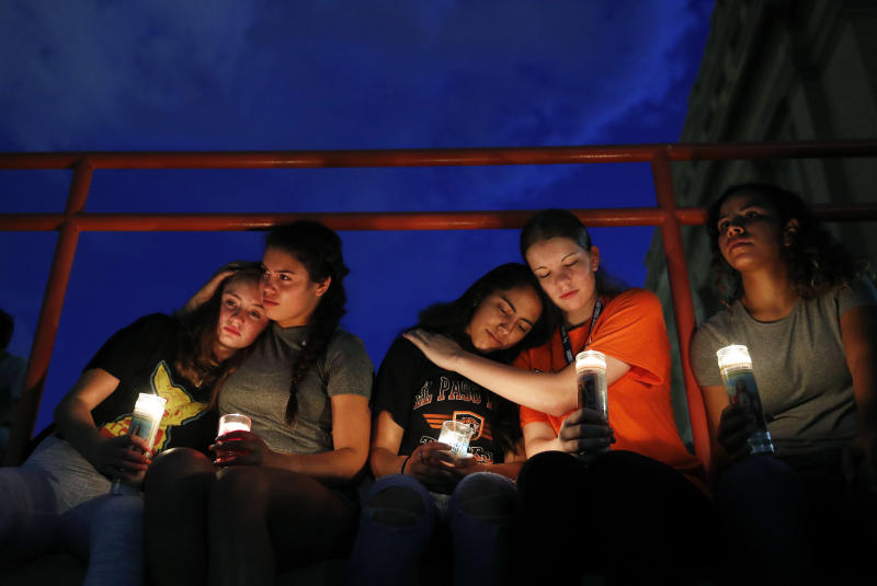 From left, Melody Stout, Hannah Payan, Aaliyah Alba, Sherie Gramlich and Laura Barrios comfort each other during a vigil for victims of the shooting Aug. 3, 2019, in El Paso, Texas. A young gunman opened fire in an El Paso, Texas, shopping area during the busy back-to-school season, leaving multiple people dead and more than two dozen injured. (Photo: John Locher/AP)