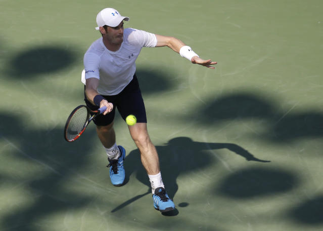 Andy Murray, of Great Britain, hits a return to Dominic Thiem during their quarterfinal match at the Miami Open tennis tournament, Wednesday, April 1, 2015, in Key Biscayne, Fla. Murray won the match 3-6, 6-4, 6-1. (AP Photo/Lynne Sladky)
