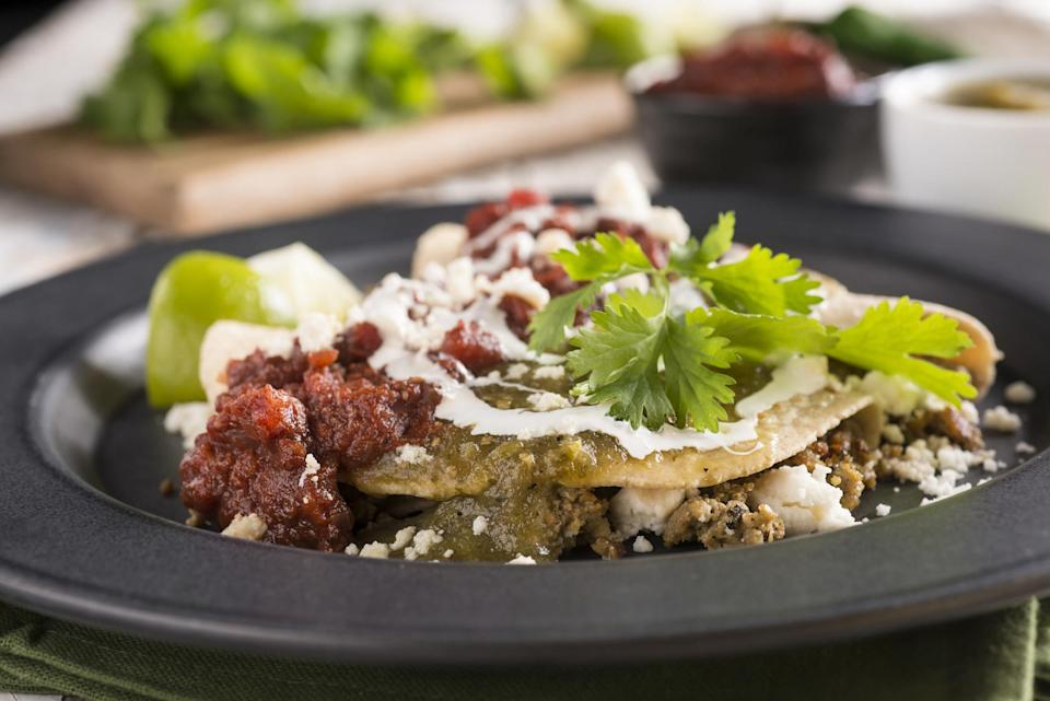 """<div><p>""""Also, carne adovada or stuffed sopaipilla smothered in red chile."""" </p><p>—<a href=""""https://www.reddit.com/user/raceclay/"""" rel=""""nofollow noopener"""" target=""""_blank"""" data-ylk=""""slk:u/raceclay"""" class=""""link rapid-noclick-resp"""">u/raceclay</a></p><p><b>Runner-up:</b> """"A green chile cheeseburger."""" —<a href=""""https://www.reddit.com/user/mewbusi/"""" rel=""""nofollow noopener"""" target=""""_blank"""" data-ylk=""""slk:u/mewbusi"""" class=""""link rapid-noclick-resp"""">u/mewbusi</a></p></div><span> Getty Images</span>"""