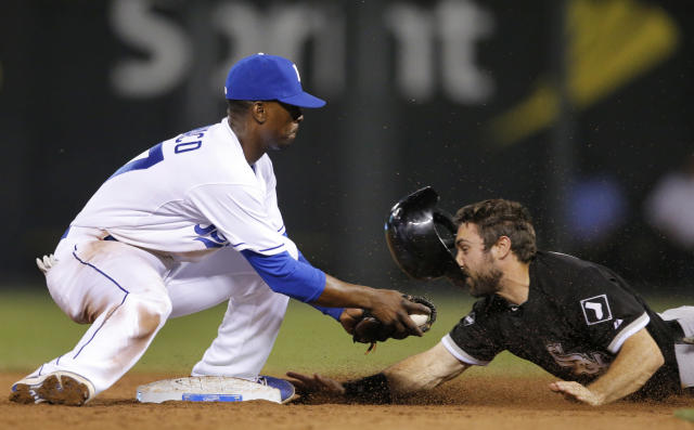 Kansas City Royals second baseman Pedro Ciriaco, left, tags out Chicago White Sox's Adam Eaton on an attempted steal during the ninth inning of a baseball game at Kauffman Stadium in Kansas City, Mo., Tuesday, May 20, 2014. (AP Photo/Orlin Wagner)