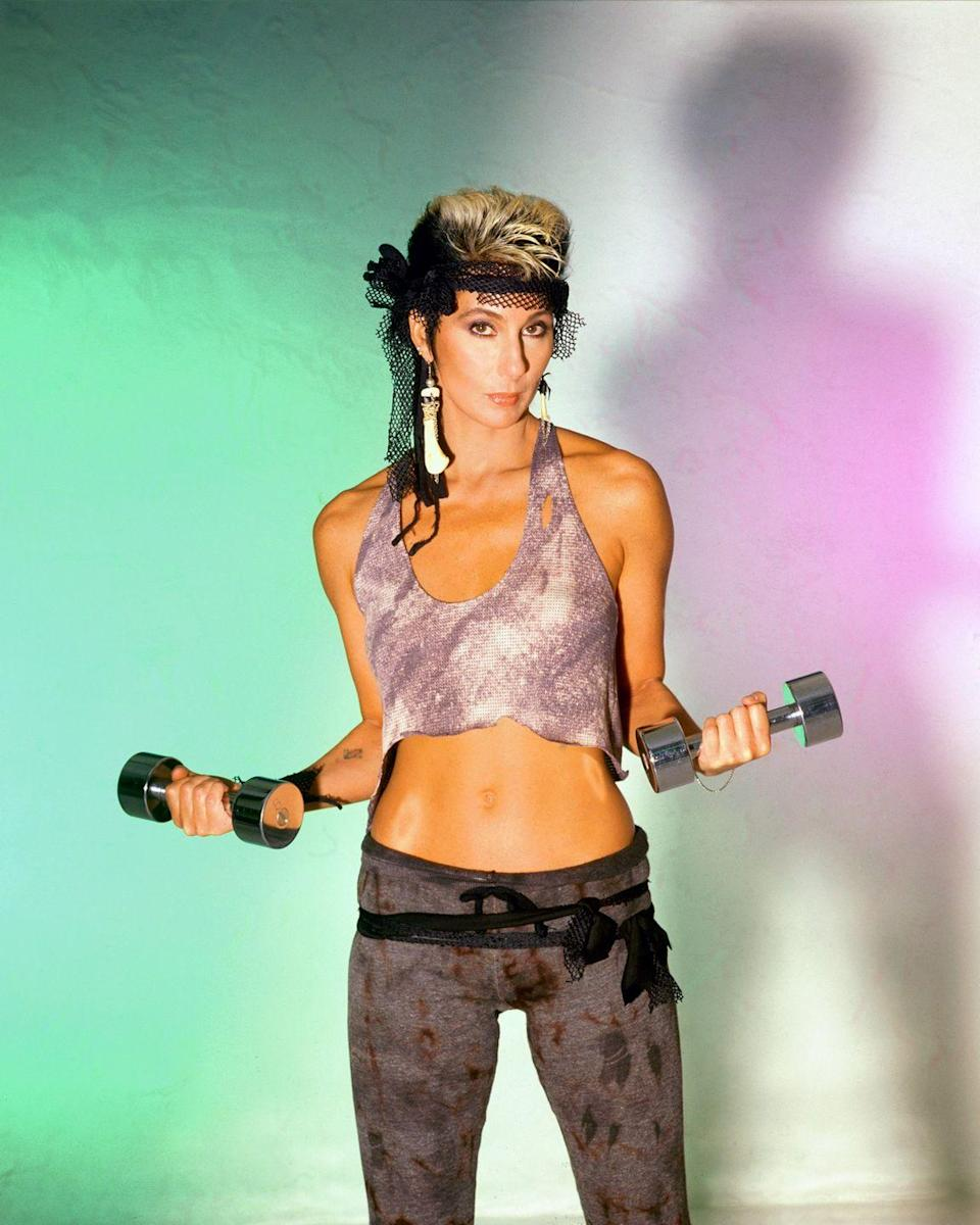 <p>Embracing the fitness movement of the '80s in a gym-ready look: a sparkling sports bra, fishnet sweatband, and printed leggings. </p>