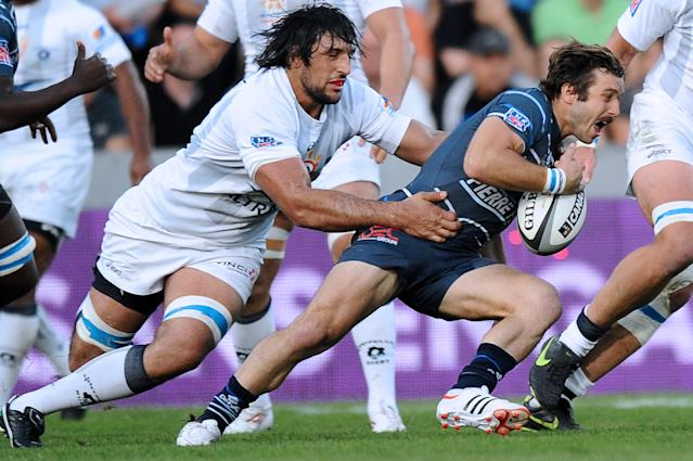 Castres' wing Marc Andreu (R) is tackled by Montpellier's lock Mickael de Marco during the French Top 14 rugby union play-off match Castres vs. Montpelliers at the Ernest Wallon Stadium in Toulouse on May 25, 2012. AFP PHOTO / REMY GABALDAREMY GABALDA/AFP/GettyImages