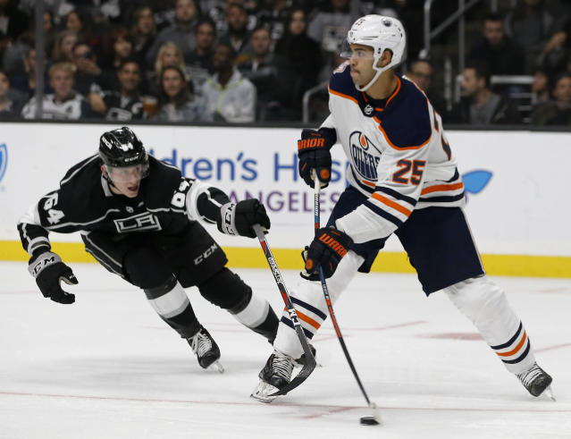 Edmonton Oilers defenseman Darnell Nurse, right, clears the puck against Los Angeles Kings right wing Matt Luff, left, during the second period of an NHL hockey game in Los Angeles, Sunday, Nov. 25, 2018. (AP Photo/Alex Gallardo)
