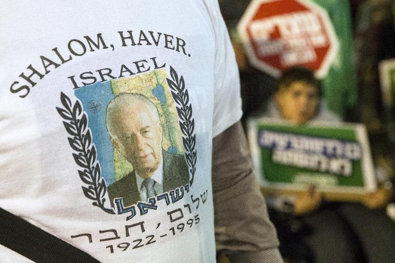 An Israeli demonstrator on November 1, 2014 wears a shirt with a portrait of Yitzhak Rabin during a rally to mark the 19th anniversary of the assassination of former Israeli Prime Minister Yitzhak Rabin at the Tel Aviv plaza where he was shot (AFP Photo/Jack Guez)