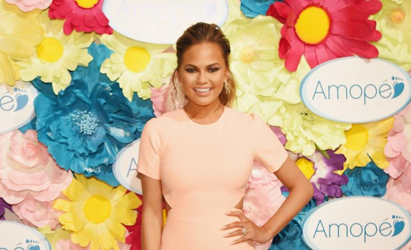 Chrissy Teigen is pregnant — and she announced it in the shadiest way possible