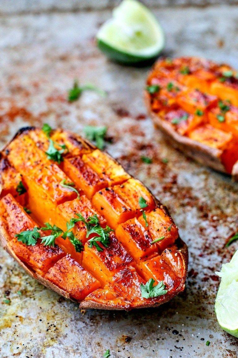"""<p>While you're probably used to topping your sweet potatoes with cinnamon, how about a little bit of a kick? This recipe brings the heat and the sweet with chili and honey.</p><p><strong>Get the recipe at <a href=""""https://www.killingthyme.net/2017/01/31/chili-honey-roasted-sweet-potatoes-with-lime-juice/"""" rel=""""nofollow noopener"""" target=""""_blank"""" data-ylk=""""slk:Killing Thyme"""" class=""""link rapid-noclick-resp"""">Killing Thyme</a>.</strong></p><p><strong><a class=""""link rapid-noclick-resp"""" href=""""https://www.amazon.com/Nordic-Ware-Natural-Aluminum-Commercial/dp/B0064OM53G/?tag=syn-yahoo-20&ascsubtag=%5Bartid%7C10050.g.877%5Bsrc%7Cyahoo-us"""" rel=""""nofollow noopener"""" target=""""_blank"""" data-ylk=""""slk:SHOP BAKING SHEETS"""">SHOP BAKING SHEETS</a><br></strong></p>"""