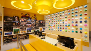 The merchandise and brick wall in the store. Photo: LEGO Group